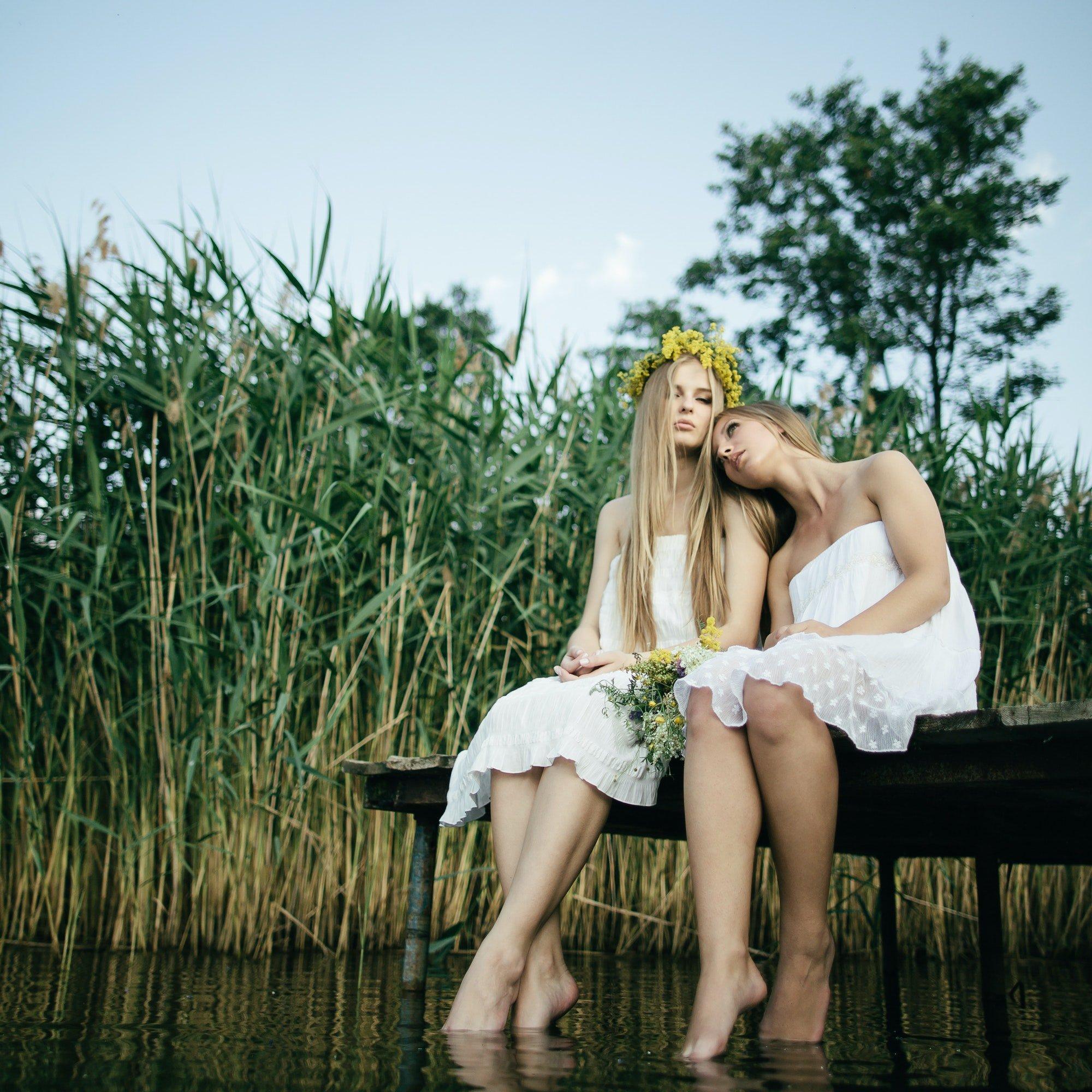 two-beautiful-girls-on-coast-at-pier.jpg